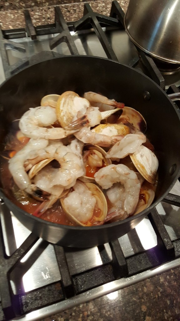 Toss in the peeled, de-veined shrimp onto the clam shells and cover with a tight fitting lid.