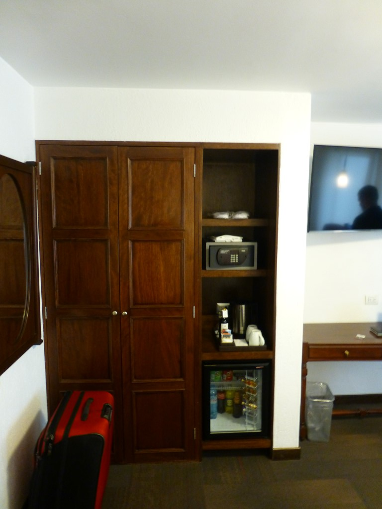 An armoire was the only closet in the room. It also housed a mini bar and the safe.